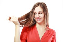 Fragile hair. Woman is not happy with her fragile hair, white background, copyspace Stock Images