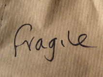 Fragile (handwritten on cardboard) Royalty Free Stock Image