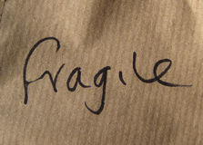 Fragile handwritten on paper Royalty Free Stock Photo