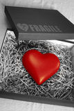 Fragile Heart. Box with a fragile heart protected with straws Royalty Free Stock Photos