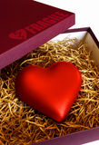 Fragile Heart. Box with a fragile heart protected with straws Stock Image