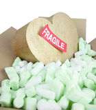 Fragile heart with sticker Royalty Free Stock Image