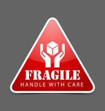 Fragile icon. Glossy fragile icon isolated on dark grey background Royalty Free Stock Photos