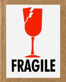 Fragile Label. Closeup of a fragile sign on a cardboard box stock photos