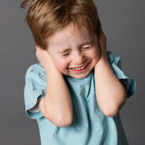 Fragile little child closing his ears and eyes against education Royalty Free Stock Photography