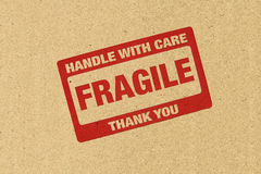 Fragile logo. On brown paper Royalty Free Stock Photos