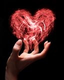 Fragile love. Hand holding smoke heart as a symbol of fragile nature of love or can symbolize someone giving love Royalty Free Stock Photos