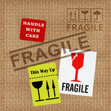 Fragile Notice. Texture of cardboard with fragile notice stock illustration