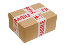 Fragile Package. Isolated view of a brown cardboard box wrapped in tape that reads fragile royalty free stock photos