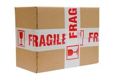 Fragile package. Package in box with tape marking it as fragile Stock Image