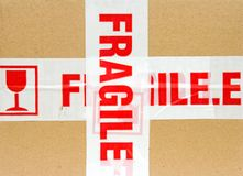 Fragile Package. Brown box or package, marked with fragile tape Royalty Free Stock Photo