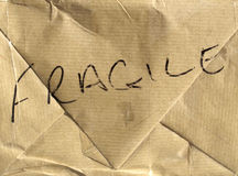 Fragile parcel. Fragile brown corrugated cardboard packet Royalty Free Stock Photos