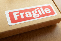 Fragile parcel for despatch. On wooden desk Royalty Free Stock Images