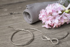Fragile pink hyacinth and linen napkin Stock Photo