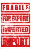 Fragile, pour l'exportation, termes commerciaux importés de marques de tampon en caoutchouc Photographie stock libre de droits