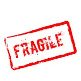 Fragile red rubber stamp isolated on white. Royalty Free Stock Image