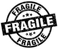 Fragile round grunge stamp. Fragile round grunge black stamp royalty free illustration