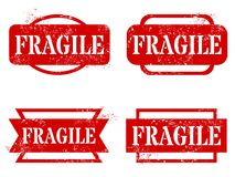 Fragile. Rubber stamps. Grungy red stamp text royalty free illustration