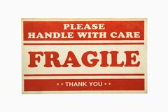 Fragile sign. Fragile handle with care sign against white background Stock Images