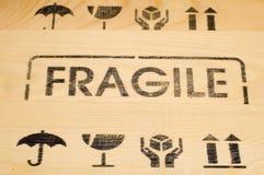 Fragile sign on wood Stock Photos