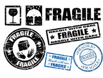 Fragile signs and stamps. Abstract grunge fragile signs and stamps royalty free illustration