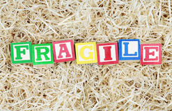 Fragile Spelled Out in Blocks in Packing Material Stock Images