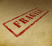 Fragile stamp on grunge background Stock Images