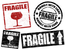 Fragile stamps. Collection of grunge office rubber stamps with word fragile written inside stock illustration
