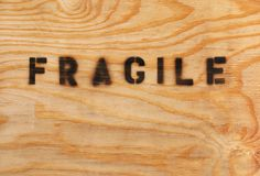 Fragile stenciled on shipping crate Stock Images