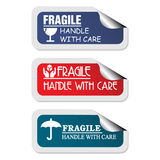 Fragile stickers. Three colorful stickers with the text fragile handle with care written inside of the stickers vector illustration