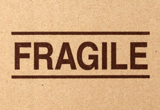 Fragile symbol on cardboard Royalty Free Stock Images