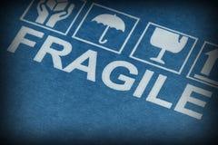 Fragile symbol on cardboard. Fine image close up of fragile symbol on cardboard stock photo
