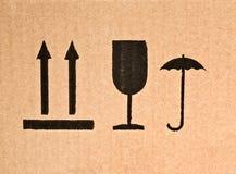 Fragile symbol on cardboard Stock Photos