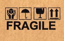 Fragile Symbol On Cardboard Royalty Free Stock Photos
