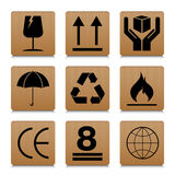 Fragile symbol set with brown cardboard texture design. Fragile symbol vector icon. Royalty Free Stock Image