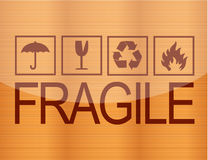 Fragile symbol on wood Royalty Free Stock Photography