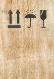 Fragile symbol on wooden background Stock Photo