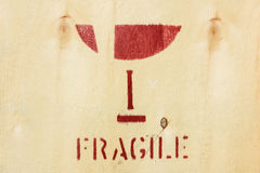 Fragile symbol on wooden box Royalty Free Stock Images