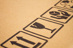 Fragile symbols on cardboard royalty free stock images