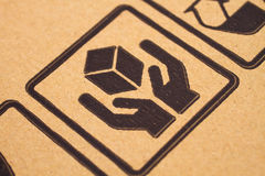 Fragile symbols on cardboard Royalty Free Stock Image