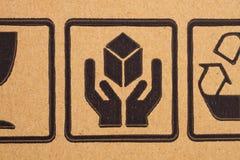 Fragile symbols on cardboard royalty free stock photos