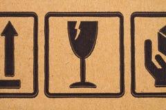 Fragile symbols on cardboard royalty free stock photography