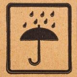 Fragile symbols on cardboard royalty free stock image