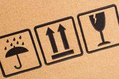 Fragile Symbols On Cardboard Royalty Free Stock Photos