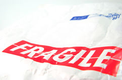 Fragile tag and old white envelope. Object Royalty Free Stock Photos