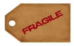Fragile Tag w/clipping path. Grungy brown tag - red grunge letters spell fragile. Clipping Path included w/file royalty free illustration