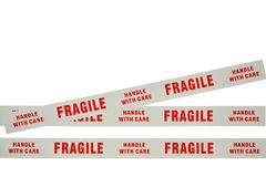 Fragile tape. Photo of fragile tape used for securing delicate items for despatch Royalty Free Stock Photos