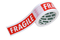 Fragile tape on a roll. A roll of fragile tape used for securing delicate items for despatch stock images