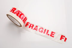 Fragile tape. Roll of packing tape on white Royalty Free Stock Photos