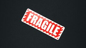 FRAGILE warning sign word text